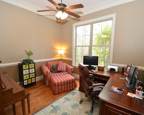 Elegant Freestanding Desk Medium Tone Wood Floor Study Room Photo In  Atlanta With Beige Walls