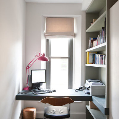 Example of a trendy built-in desk home office design in Other