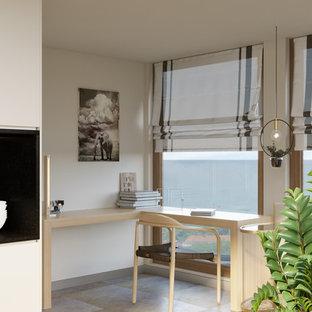 Idee per un piccolo atelier moderno con pareti beige, pavimento con piastrelle in ceramica, nessun camino, scrivania incassata e pavimento multicolore