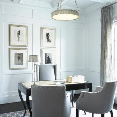 Elegant freestanding desk dark wood floor home office photo in Other with white walls