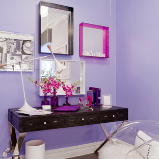 This is an example of an eclectic home office in New York with purple walls, carpet and a freestanding desk.