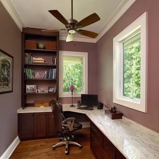 Contemporary home office and library in Charleston with purple walls, medium hardwood flooring and a built-in desk.