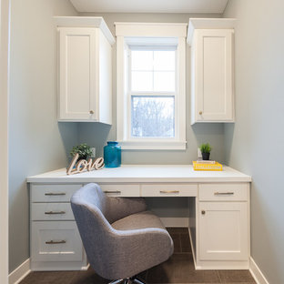 Mid-sized country built-in desk ceramic tile and brown floor study room photo in Minneapolis with green walls