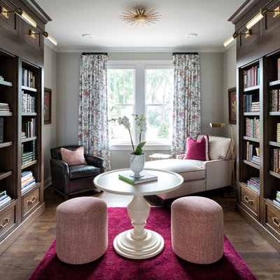Inspiration for a timeless dark wood floor home office library remodel in Minneapolis with gray walls