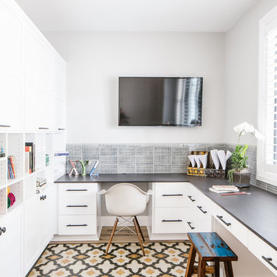 Inspiration for a country built-in desk multicolored floor home office remodel in Seattle with gray walls
