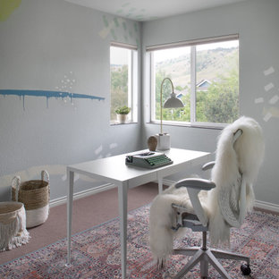 Example of a mid-sized eclectic freestanding desk carpeted home office design in Denver with blue walls