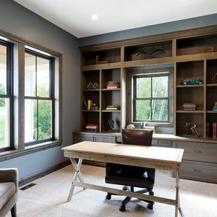 Inspiration for a timeless freestanding desk carpeted study room remodel in Minneapolis with blue walls
