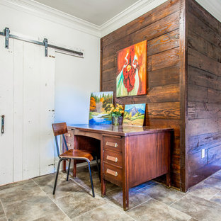 Inspiration for a small transitional freestanding desk ceramic floor home office remodel in Houston with white walls