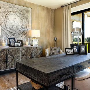 Large farmhouse freestanding desk medium tone wood floor and beige floor study room photo in Portland with brown walls