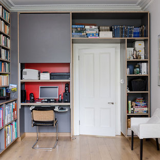 Inspiration for a contemporary home office and library in Other with a built-in desk.