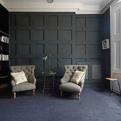 Transitional carpeted study room photo in London with black walls