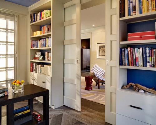 Trendy Freestanding Desk Dark Wood Floor Home Office Photo In Denver With  Blue Walls