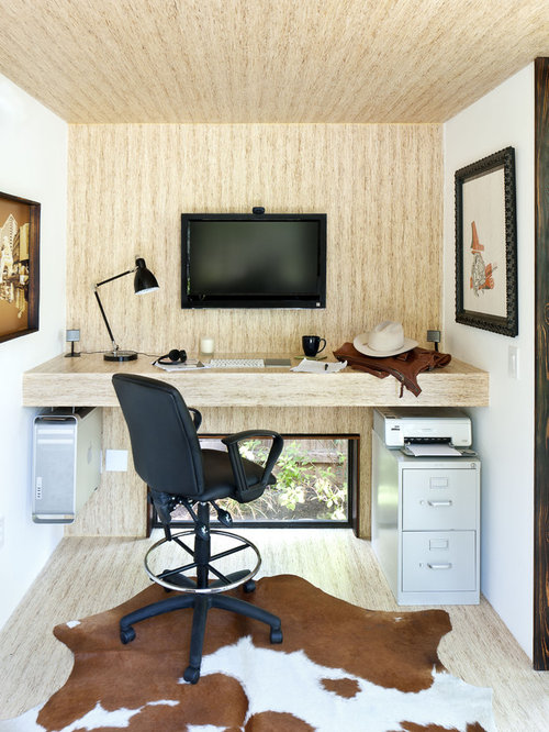 example of a mid sized minimalist built in desk home office design in austin