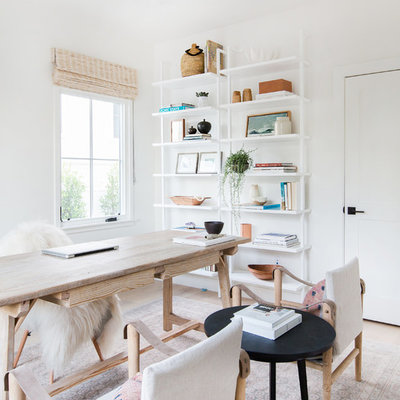 Inspiration for a transitional freestanding desk light wood floor home office remodel in San Diego with white walls
