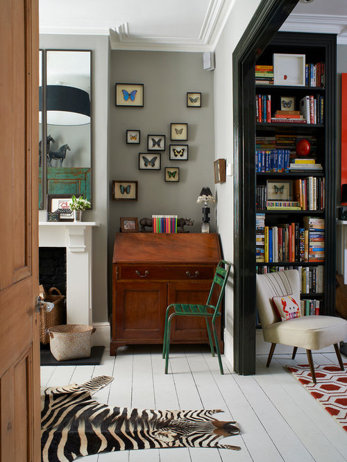 home office rug placement. example of an eclectic white floor home office design in london rug placement