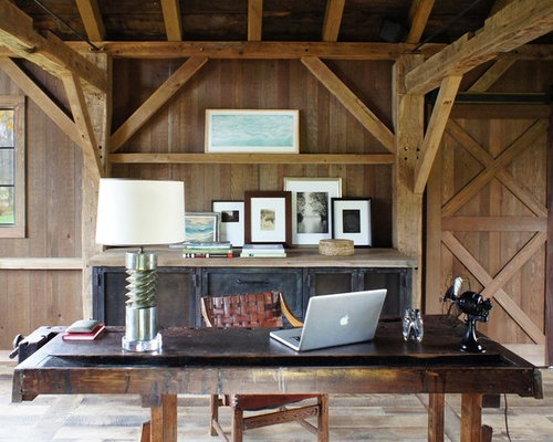 country home office. photo of a midsized country home studio in new york with freestanding desk office c