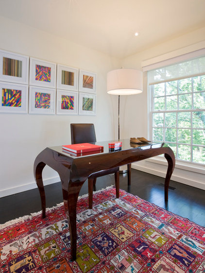 contemporary home office by FORMA Design, brown office desk with brown chair, colorful rug, colorful wall art