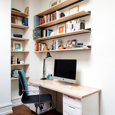 Home office - eclectic freestanding desk medium tone wood floor and brown floor home office idea in Philadelphia with white walls