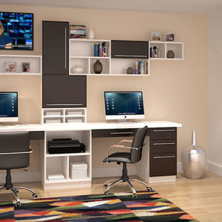 Mid-sized trendy built-in desk study room photo in Los Angeles with beige walls