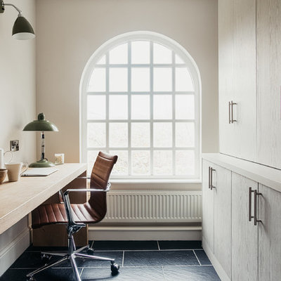 Example of a country freestanding desk black floor study room design in Other with white walls and no fireplace
