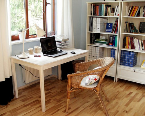 example of an eclectic home office design in other with gray walls medium tone wood