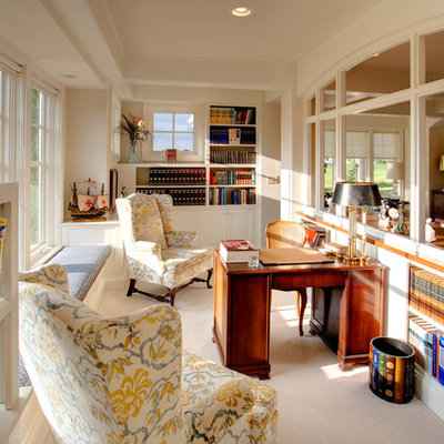 Study room - mid-sized traditional freestanding desk carpeted study room idea in Milwaukee with beige walls