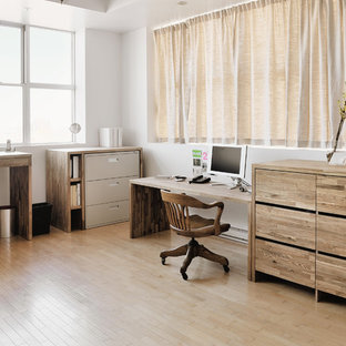 Mid-sized trendy freestanding desk light wood floor and beige floor home office photo in Montreal with white walls
