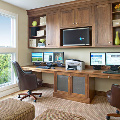 Home office - coastal built-in desk home office idea in New York