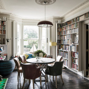 Design ideas for a medium sized bohemian home office in London with a reading nook, grey walls, dark hardwood flooring, a freestanding desk and brown floors.