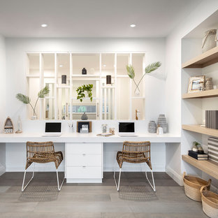 This is an example of a beach style study room in Sydney with white walls, no fireplace, a built-in desk and grey floor.