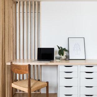 Mid-century modern home office photo in Denver