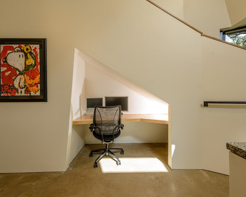 under stairs furniture. Small Trendy Built-in Desk Concrete Floor Study Room Photo In Austin With White Walls Under Stairs Furniture