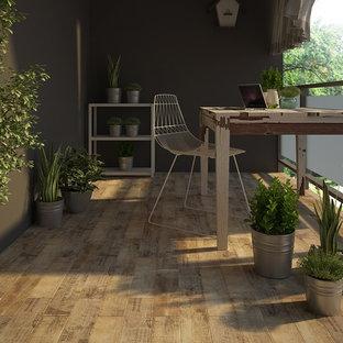 Idéer för ett modernt arbetsrum, med klinkergolv i porslin