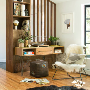 1950s freestanding desk light wood floor home office photo in Denver with white walls