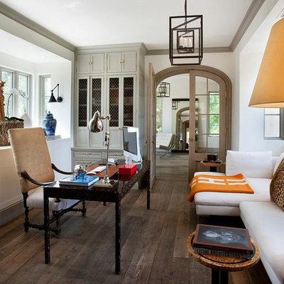 Study room - mediterranean dark wood floor study room idea in Phoenix with white walls