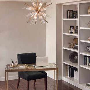 Example of a mid-sized transitional freestanding desk dark wood floor and brown floor study room design in Phoenix with beige walls and no fireplace