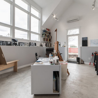 Example of a large minimalist freestanding desk concrete floor and gray floor craft room design in Chicago with multicolored walls