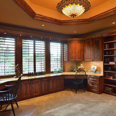 Rustic Home Office by Artisan Homes and Design