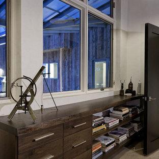 Example of a mid-sized minimalist freestanding desk home studio design in Denver