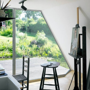 Inspiration for a contemporary home studio remodel in London with white walls