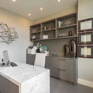 Inspiration for a contemporary freestanding desk study room remodel in Vancouver with gray walls