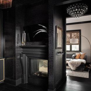 サンフランシスコの中くらいのトランジショナルスタイルのおしゃれな書斎 (黒い壁、濃色無垢フローリング、両方向型暖炉、木材の暖炉まわり、黒い床) の写真