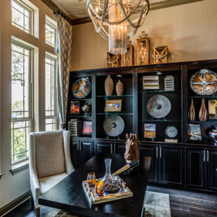 Inspiration for a small timeless freestanding desk study room remodel in Austin with beige walls