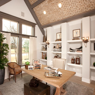 Inspiration for a large transitional freestanding desk light wood floor study room remodel in Dallas with white walls