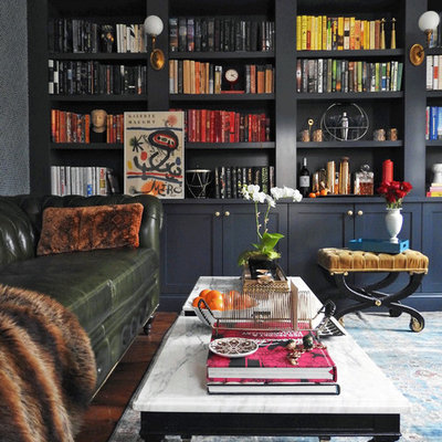 Inspiration for a mid-sized timeless medium tone wood floor and brown floor home office library remodel in New York with gray walls and no fireplace