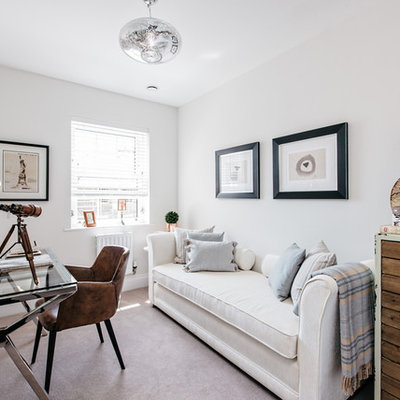 Farmhouse freestanding desk carpeted study room photo in London with white walls