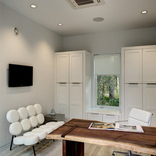 Home office - contemporary freestanding desk light wood floor home office idea in Orlando with white walls