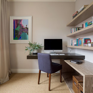 Inspiration for a small traditional study in London with beige walls, a built-in desk, beige floors and carpet.