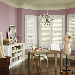 Photo of a traditional craft room in Other with purple walls, dark hardwood flooring and a freestanding desk.