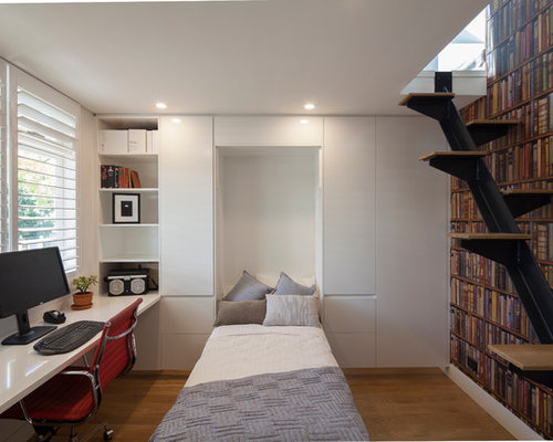 small minimalist built in desk medium tone wood floor home office photo in sydney with - Modern Home Office